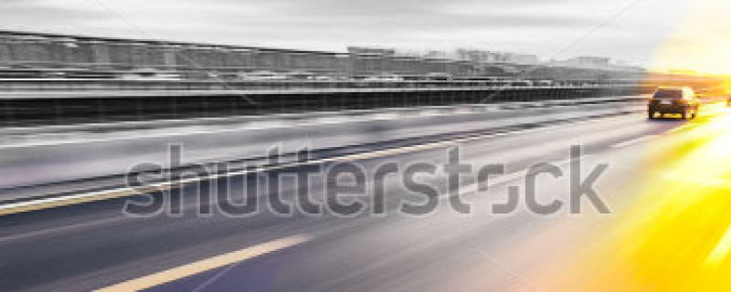 stock-photo-car-driving-on-freeway-at-sunset-motion-blur-205799656kopie