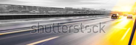 stock-photo-car-driving-on-freeway-at-sunset-motion-blur-205799656kopie